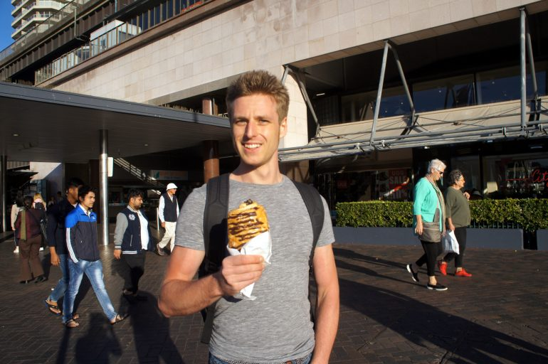 Cez enjoying chocolate croissant in Sydney