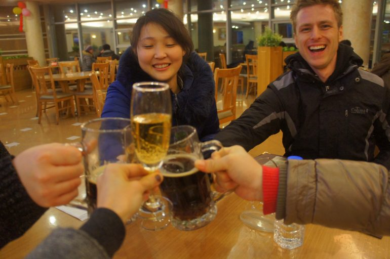 Enjoying local beer in North Korea