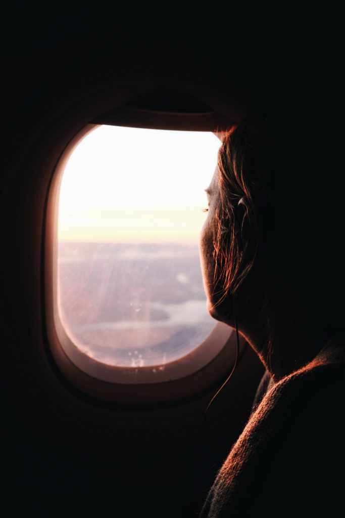 Sitting on a plane by the window